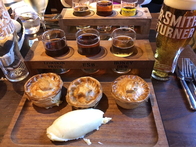 Pie and ale sampling in a traditional London pub